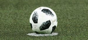 A ball placed in the center ready for kick-off