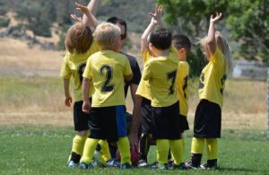 Soccer Kids Talking With The Coach