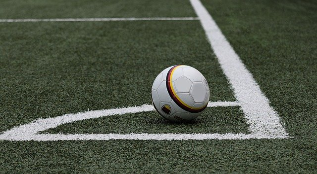 A soccer ball placed on the corner position