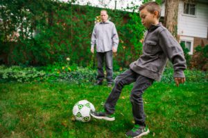 father-and-son-playing-soccer-drill