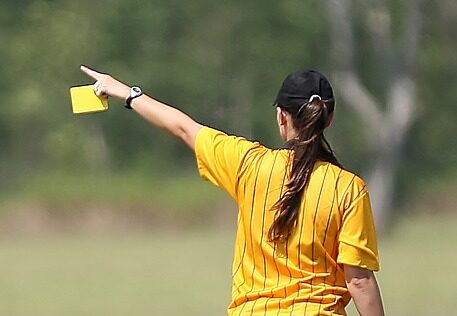 Basic Soccer Rules For Kids - A referee showing a yellow card