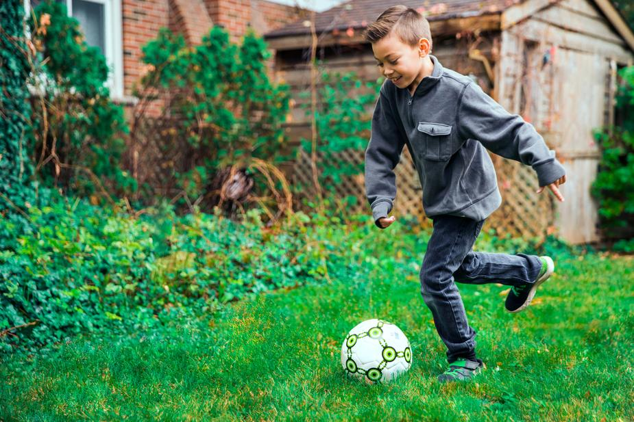 What Is The Striker Position In Soccer - young-boy-kicking-ball-drill