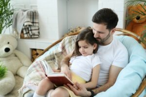 dad and daughter reading at home