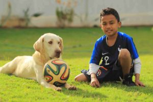 boy with ball and his dog