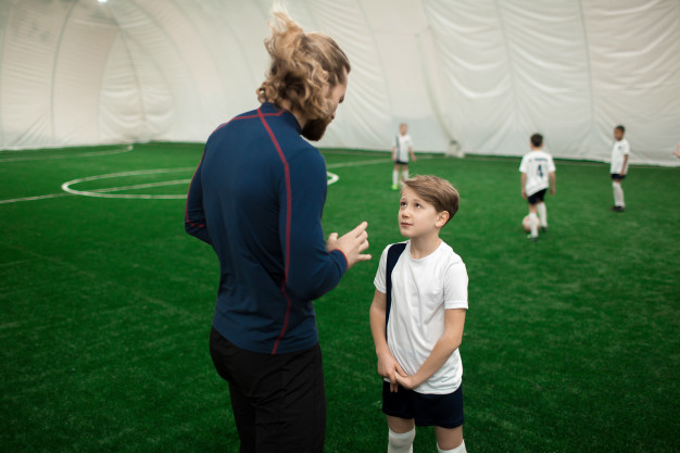 Trainer talking to a player
