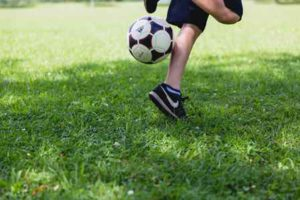 A kid playing with the soccer ball