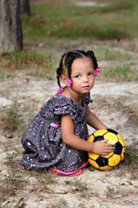 Baby girl play with soccer ball