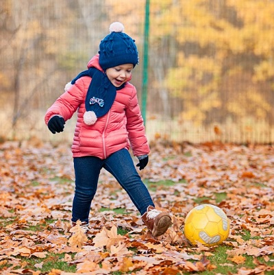 Soccer Drills For Toddlers - girl kicking a ball