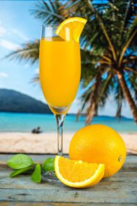 Benefits Of Citrus Fruits - Orange juice at the beach