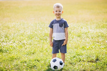 Advantages of one-on-one soccer training - Little boy playing football at the field