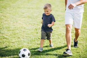 Advantages of one-on-one soccer training - Father and son chasing the soccer ball