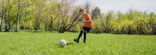 How To Kick A Soccer Ball - A Boy Passing The Ball