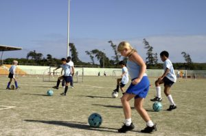 Kids practicing soccer drills