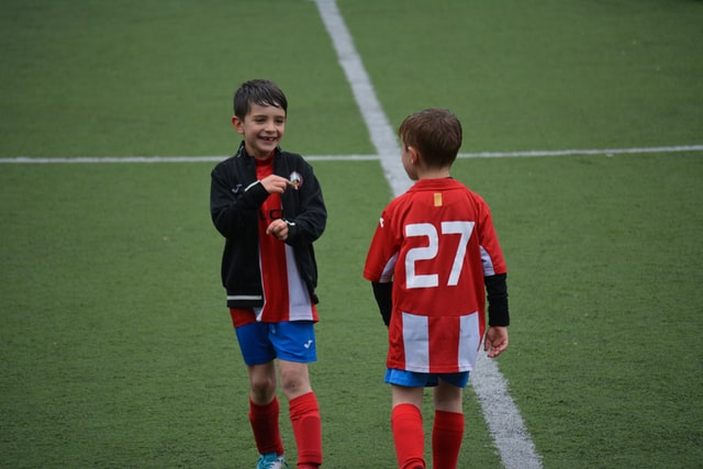 Two boys playing soccer
