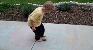 A Kid Playing Hopscotch