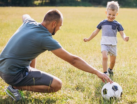 Soccer Activities For kids - Father Coaching His Son