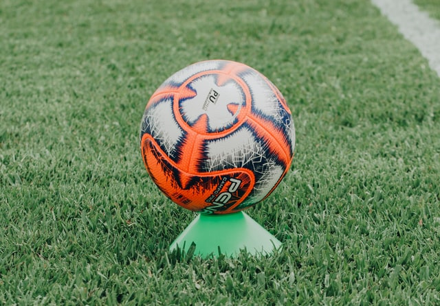 A soccer ball placed on a cone