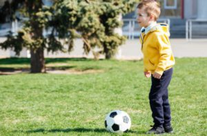 Soccer Winger Position - Boy ready to kick a ball
