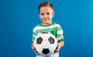 Soccer Winger Position - Boy Holding A Ball