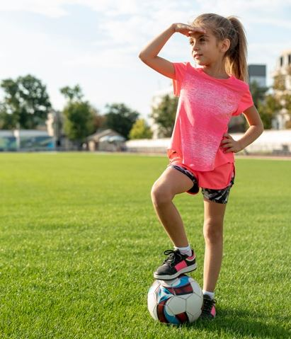 How To Teach Your Child To Play Soccer - A girl pauses during soccer training
