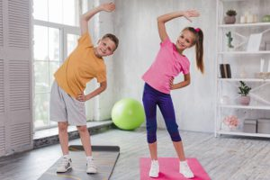 Soccer stretch for kids - lateral stretch