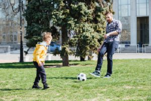 What Is The 1000 Soccer Touches - father and son doing passing drill