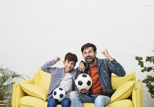 What Is The 1000 Soccer Touches - father and son watching soccer on tv
