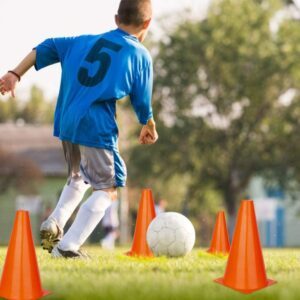 A boy performing a cone drill
