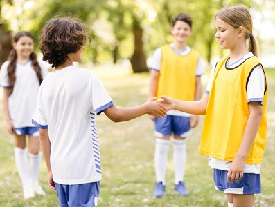 Boy shaking the hands of a teammate